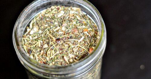 Overhead view of homemade Italian seasoning in a pint sized mason jar