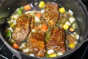Buffalo short ribs, carrots and bone broth in the dutch oven