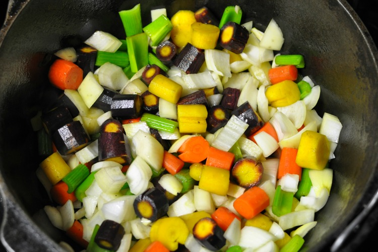 Rainbow carrots in the bottom of a cast iron dutch oven