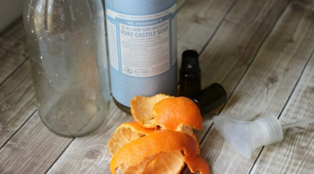Orange peels with essential oils and soap bottle