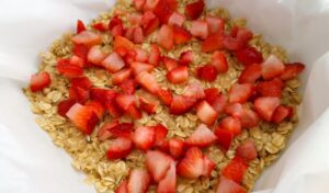 Diced strawberries sprinkled over the oatmeal crust