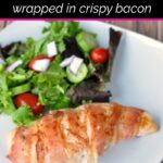 White dinner plate with bacon wrapped jalapeno popper chicken breast and dinner salad