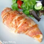 Close up of jalapeno popper stuffed chicken breast wrapped in nitrate free bacon