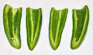 Two jalapenos sliced in half, deseeded and cleaned
