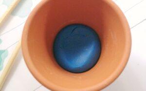 modeling clay in a terra cotta pot
