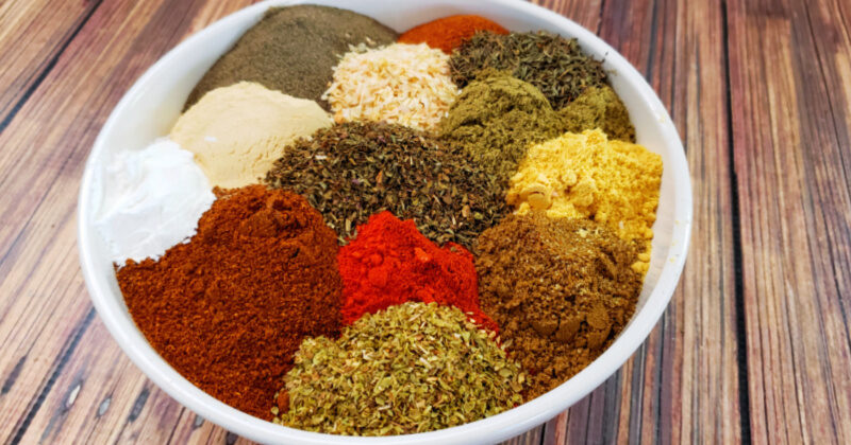 Bowl of dried spices and seasonings to make homemade cajun seasoning
