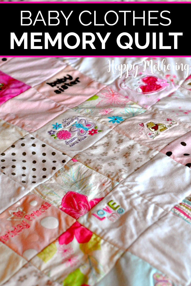 Memory quilt made from baby clothes spread out on the bed so you can see each square