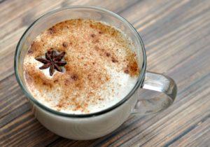 Chai latte in a clear glass mug