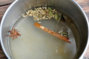 Chai spices simmering in water