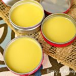 Close up of three tins of DIY sinus relief body balm cooled and ready to use