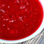 Close up of honey orange cranberry sauce in white bowl