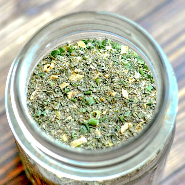 Close up of homemade ranch seasoning in a glass jar
