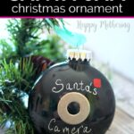 Homemade Santa Cam ornament with a tree branch on a table