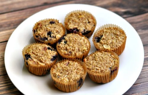 7 baked oatmeal blueberry muffins on a white plate