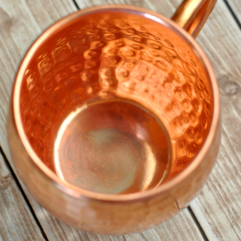 Close of of newly cleaned copper mug on the table