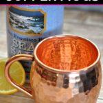 Copper mug, sea salt package and half a lemon on a table