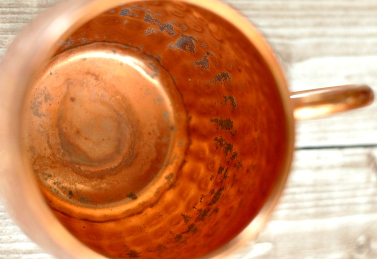 Tarnished copper mug that needs to be cleaned