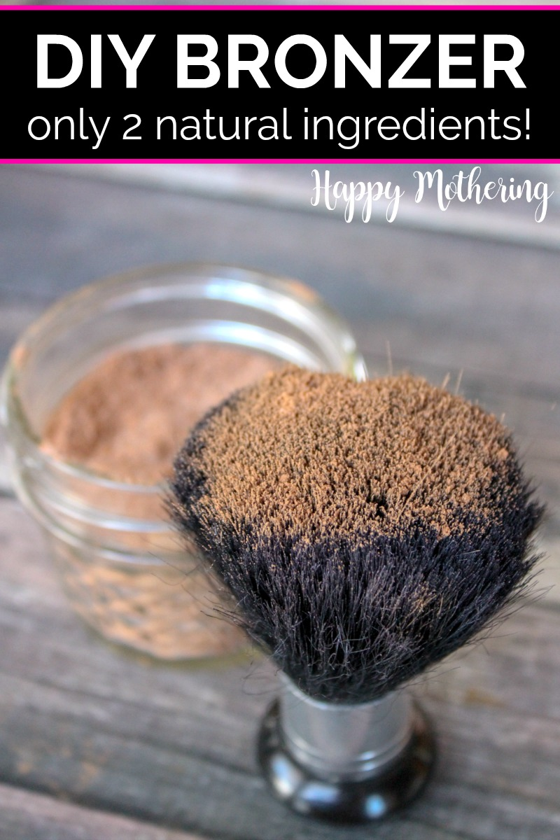 Large makeup brush dipped in DIY bronzer that is stored in a jelly jar set on a wood table