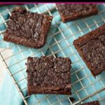 Gluten free black bean brownies on a wire cooling rack
