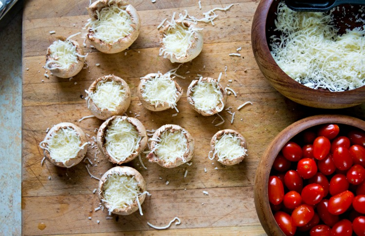 Cheese stuffed into white button mushroom tops