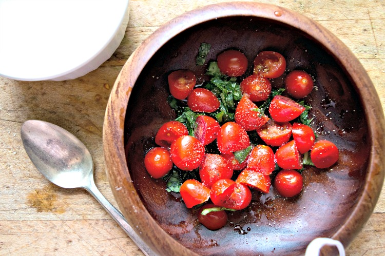 Tomatoes and basil in a bowl