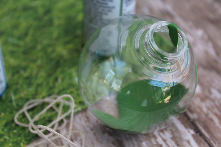 Green paint in a clear fillable Christmas ornament