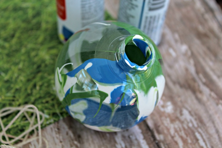 Blue, white and green paint in clear fillable ornament