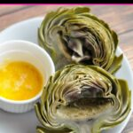 Overhead view of two artichoke halves on a white plate with butter that were prepared in the Instant Pot