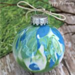 Close up of swirled paint white, blue and green Christmas ornament