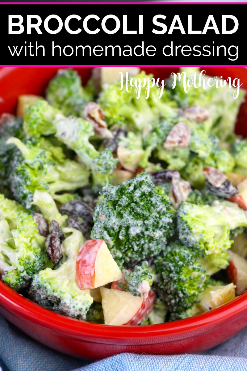 Close up of homemade broccoli salad with creamy dressing in a red bowl