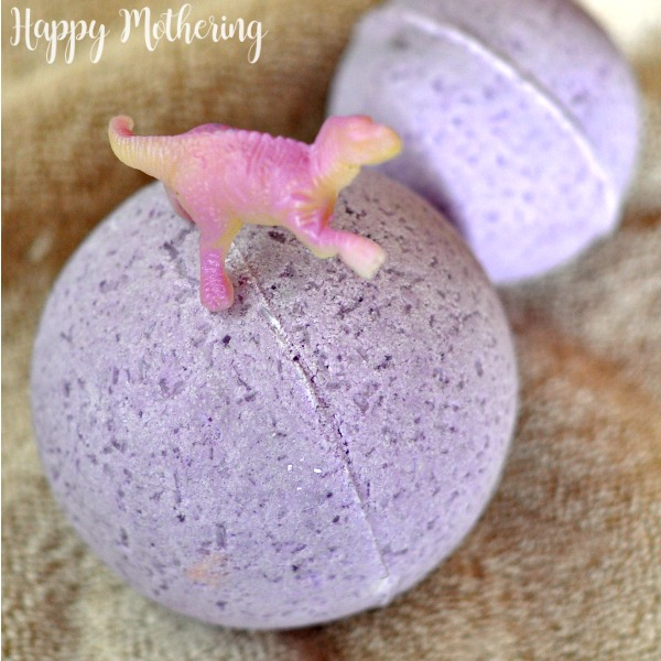 Close up of DIY bath bomb for kids with a toy dinosaur