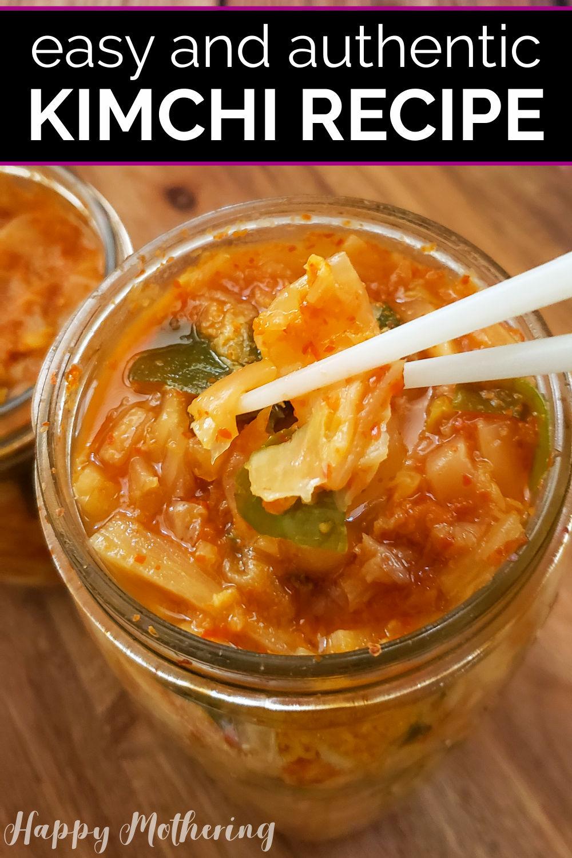 Chopsticks picking up kimchi out of a mason jar.