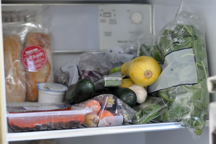 All ingredients from a Blue Apron meal kit on the shelf of the refrigerator