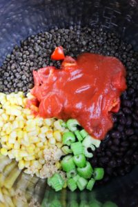 Beans, corn, celery and tomato sauce in the Instant Pot