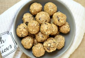 Peanut butter energy bites in a grey bowl