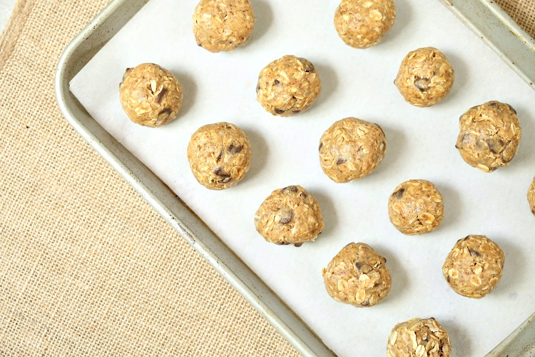 Peanut butter energy bites rolled out on a baking sheet