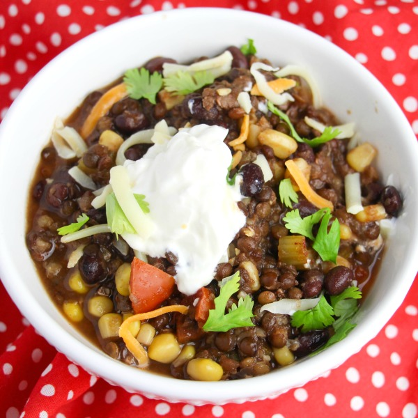 Overhead shot of vegetarian chili topped with sour cream and cheese after being made in an Instant Pot