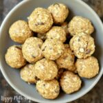 Square crop of peanut butter energy bites in a bowl
