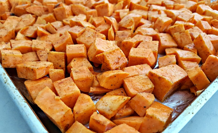 Roasted sweet potatoes on a sheet pan