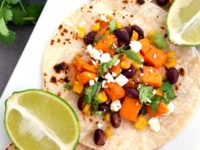 Are you looking for a delicious vegetarian recipe for Meatless Monday? These Honey Lime Sweet Potato, Black Bean and Corn Vegetarian Tacos are the best!