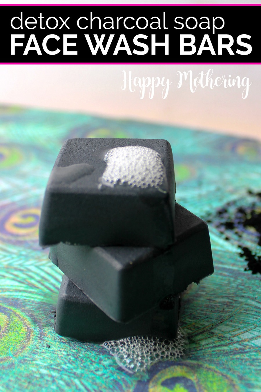 Three activated charcoal face wash bars lathered up