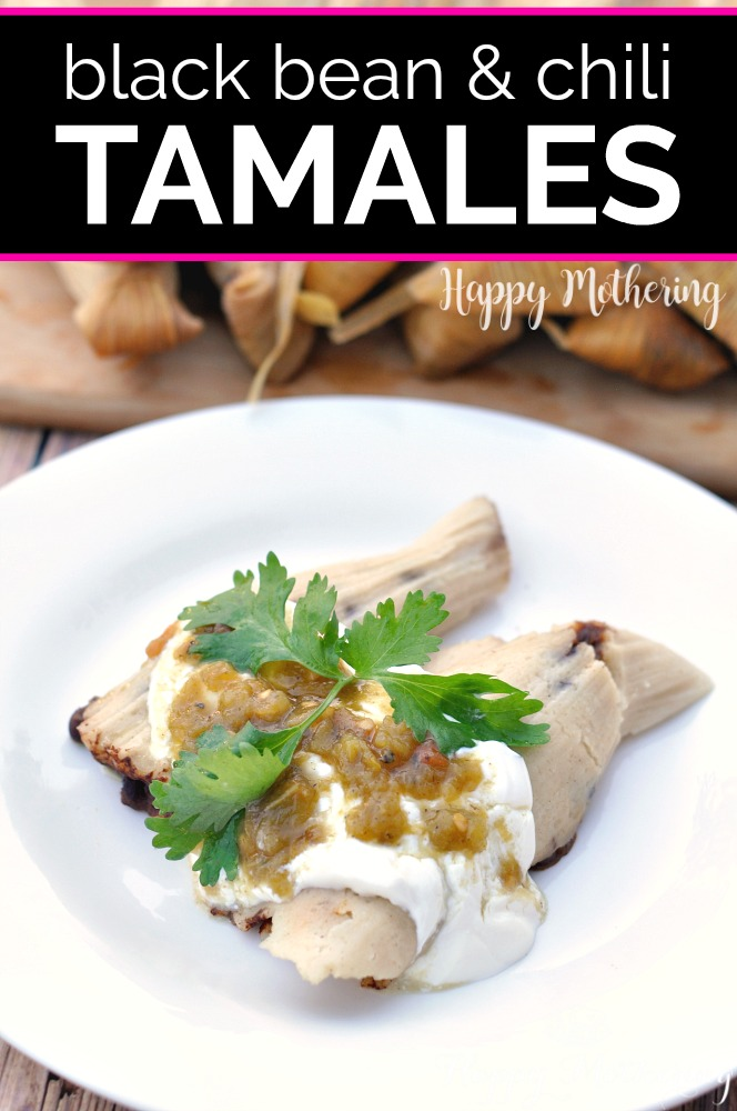 Two homemade black bean tamales topped with sour cream, salsa verde and cilantro