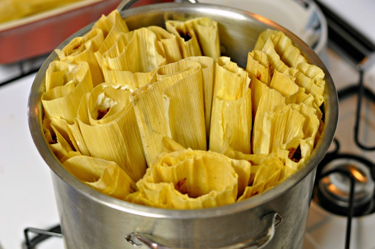 Tamales arranged into a steamer pan ready to be cooked