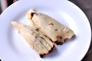 Finished tamales on a white plate