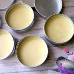 Menstrual cramps pain relief salve containers on a table