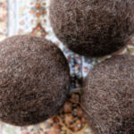 Want wool dryer balls for your natural laundry routine but they're too expensive? Follow this tutorial for DIY wool dryer balls that are easy on the budget.
