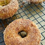 Pumpkin snickerdoodle gluten free donuts on a cooling rack