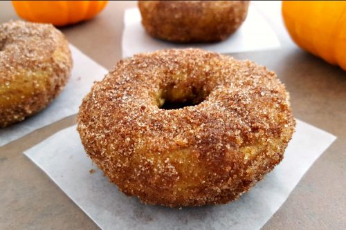 Pumpkin Snickerdoodle donut on a parchment paper square