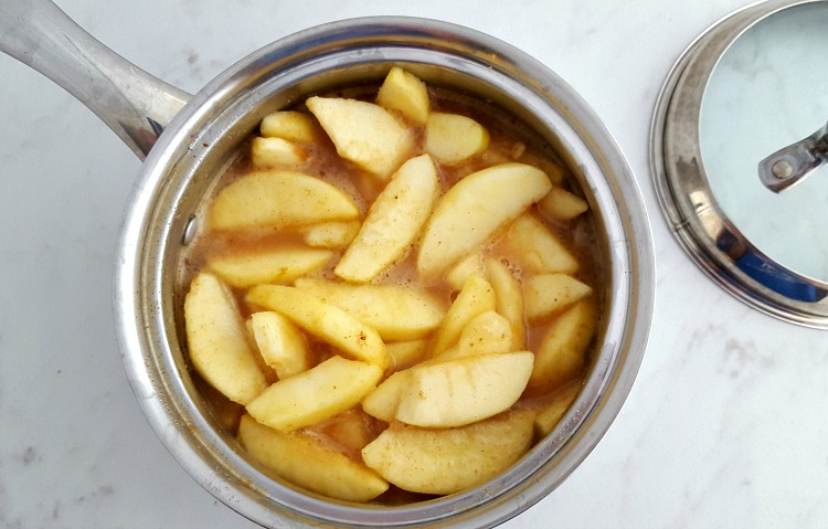 apple pie filling cooking in a pan