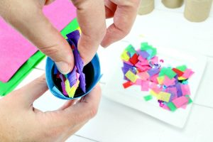 Add the confetti to the DIY party popper